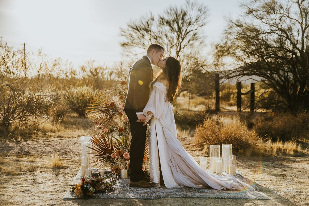 rebecca skidgel photography arizona elopement wedding photographer bride and groom first kiss during ceremony