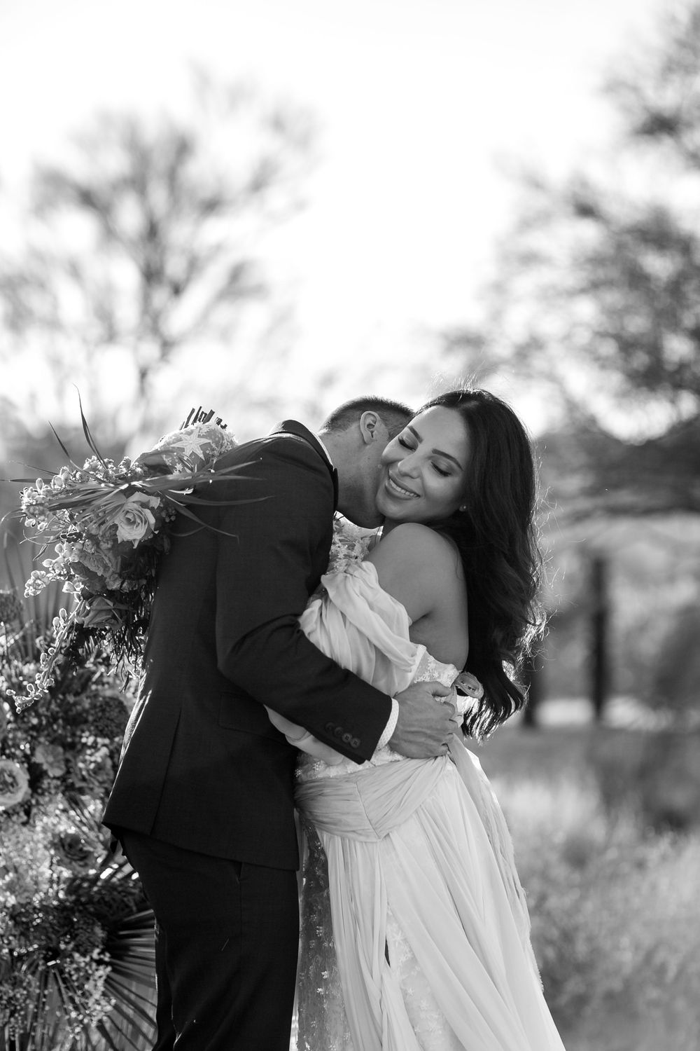 rebecca skidgel photography arizona elopement wedding photographer groom kissing brides neck making her laugh
