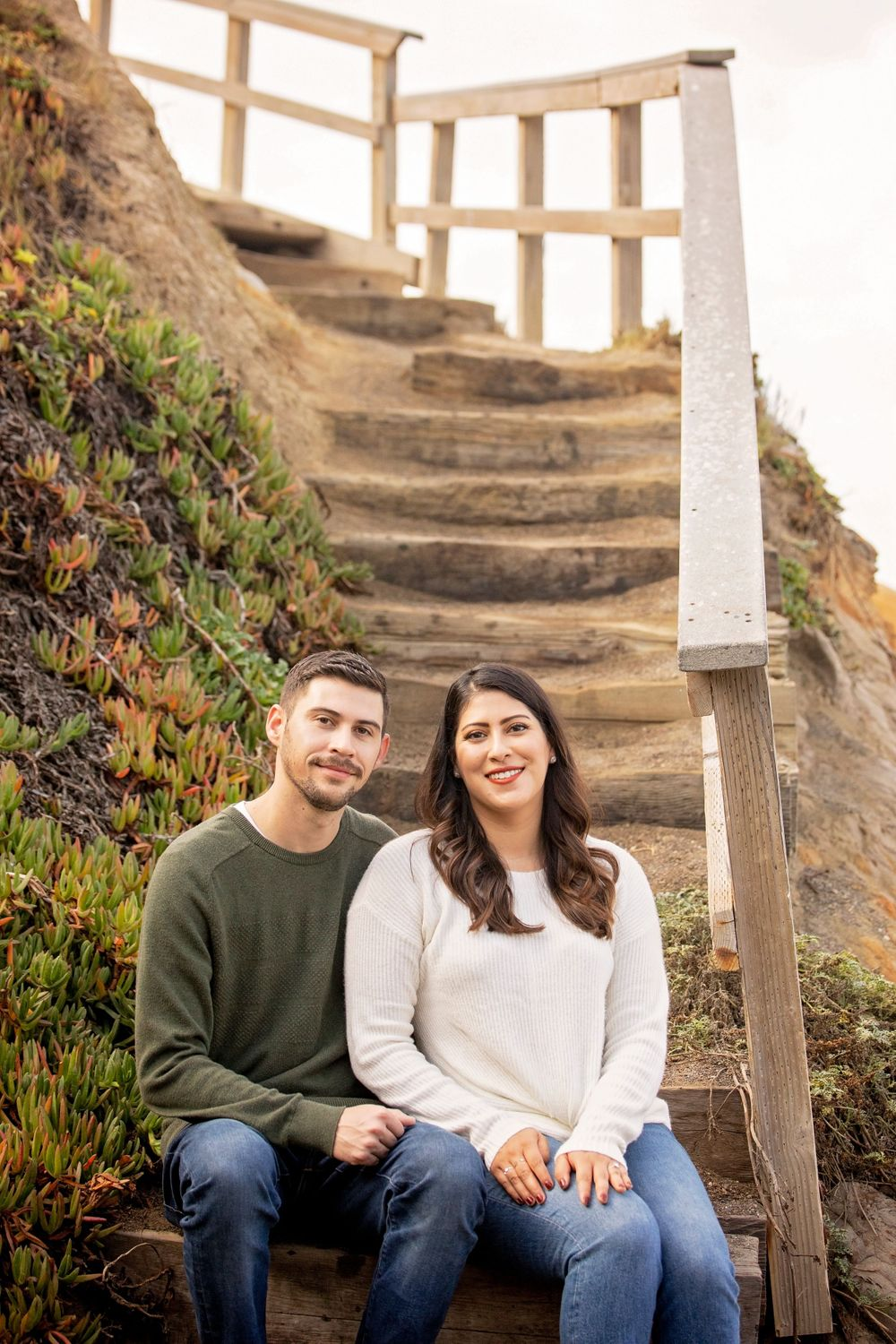 Couple sitting on stairs at Moonstone Beach