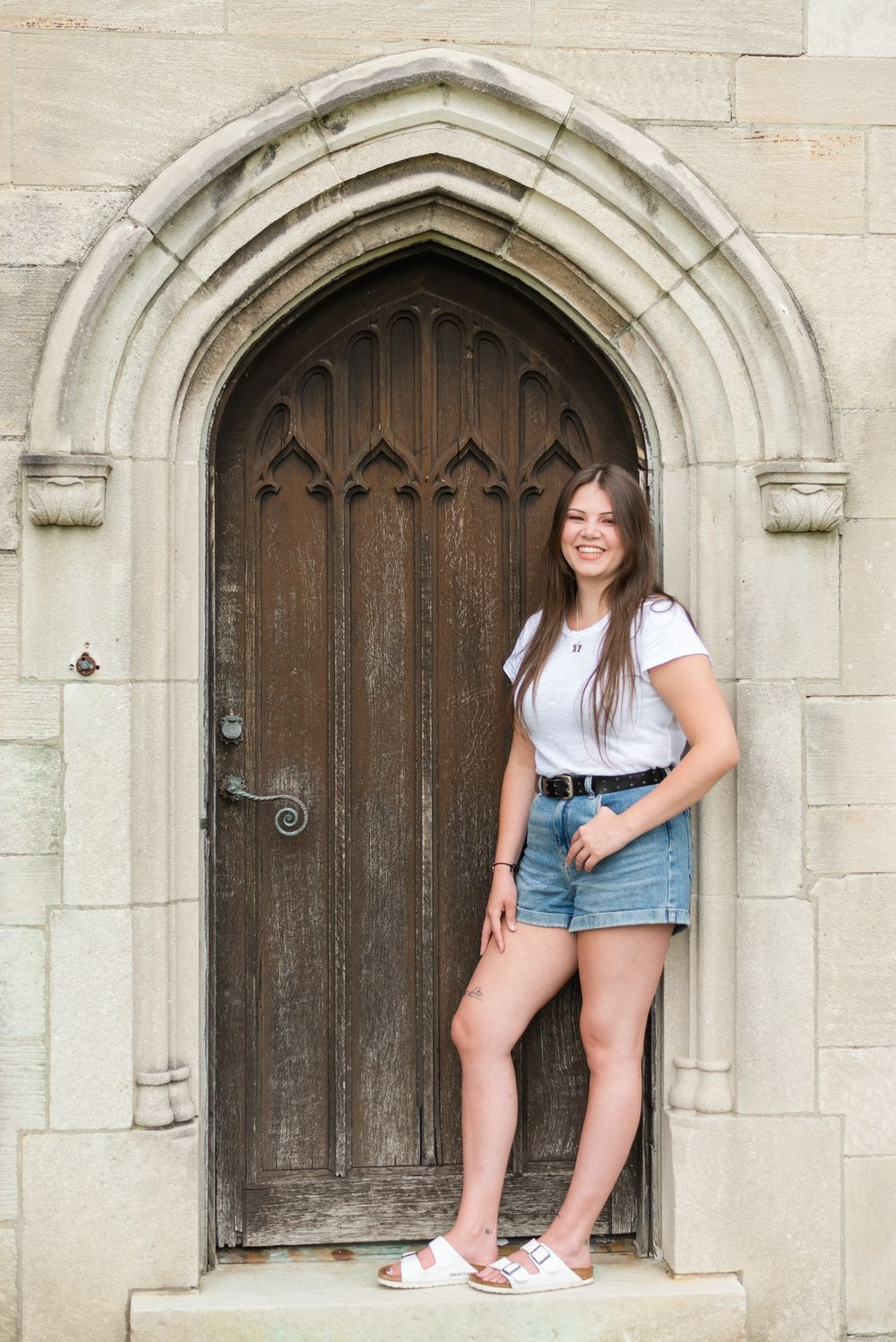 Girl laughing in old doorway at Hartwood Acres in Pittsburgh Pennsylvania