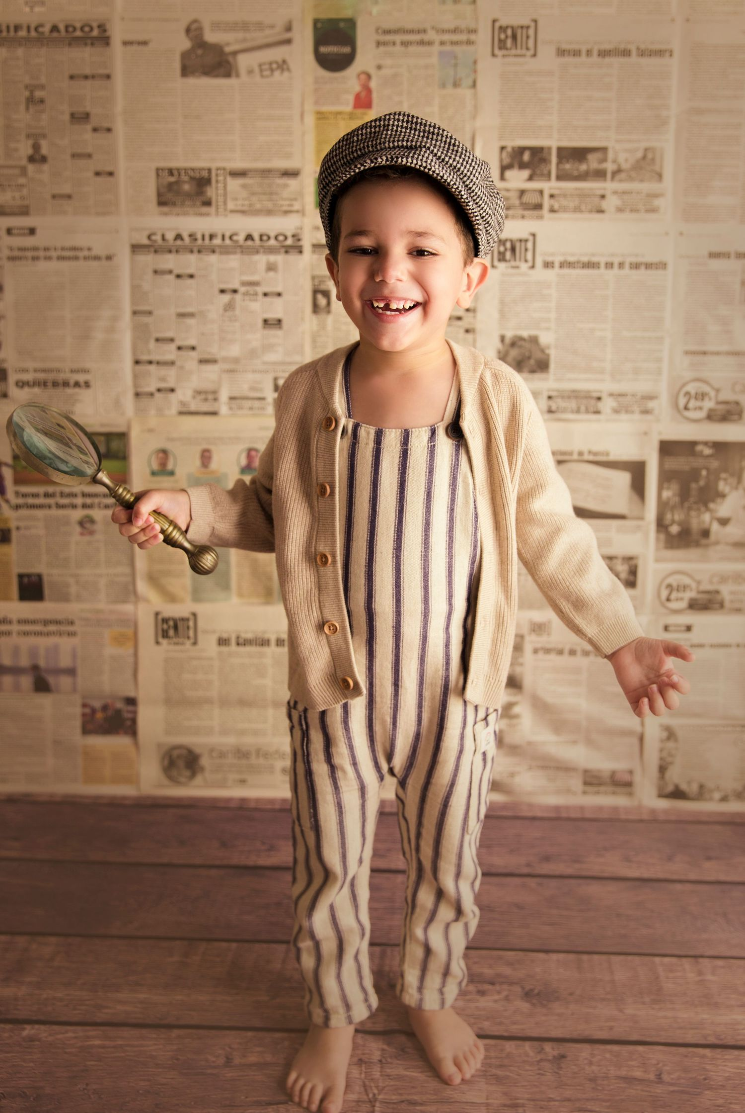 happy 4 year old using overalls newspaper backdrop