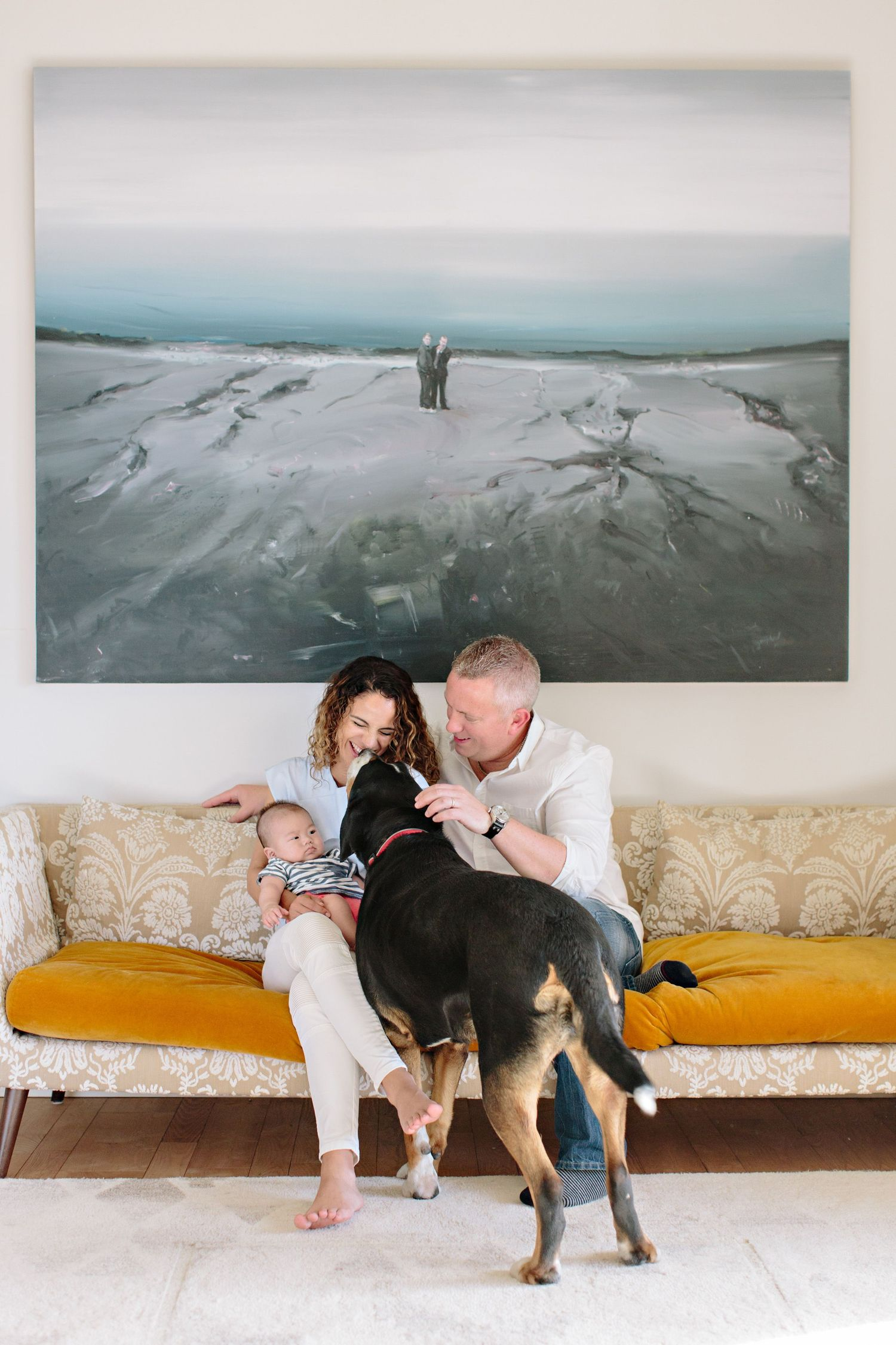 family and artwork with dog