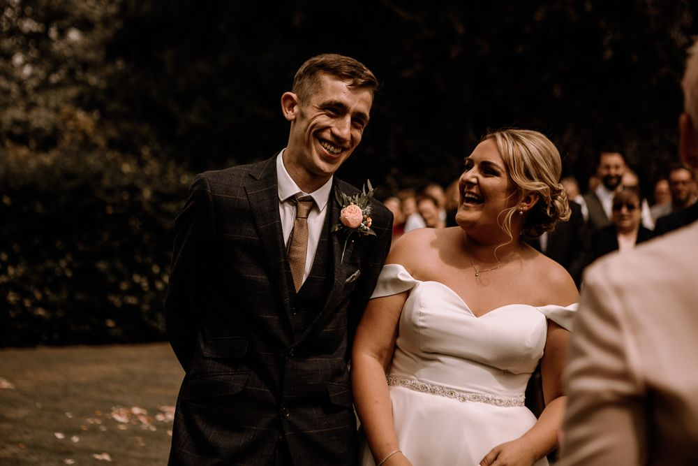 bride and groom at wedding ceremony at north west wedding venue parr hall farm