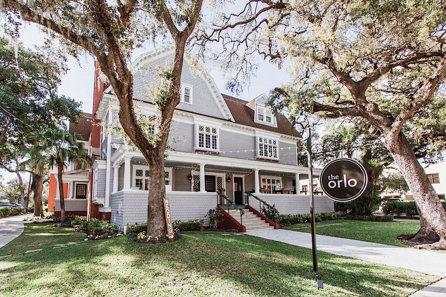 The Orlo, a historic wedding venue in Tampa, FL which is a gray two story house