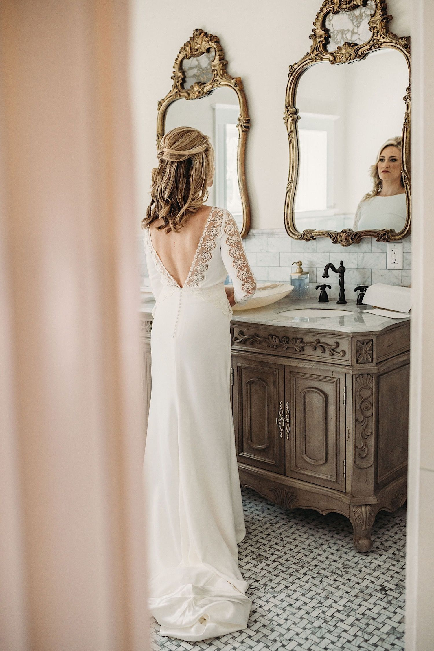 bride looking in the mirror in the bathroom of the Orlo in tampa