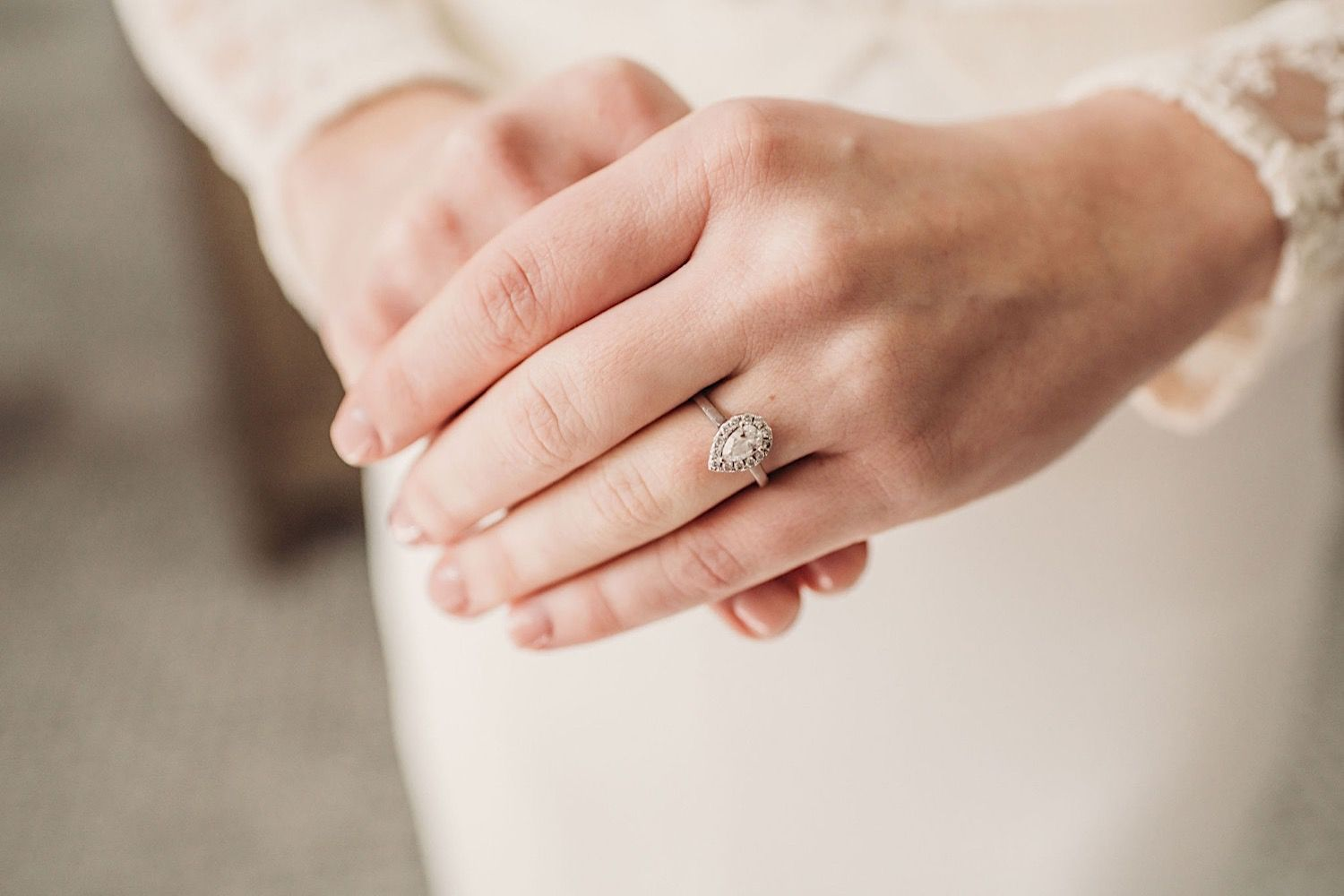 Close up of the bride's hands showing her engagement ring