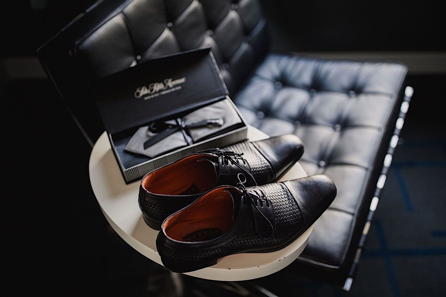 Groom's wedding shoes sitting on a table