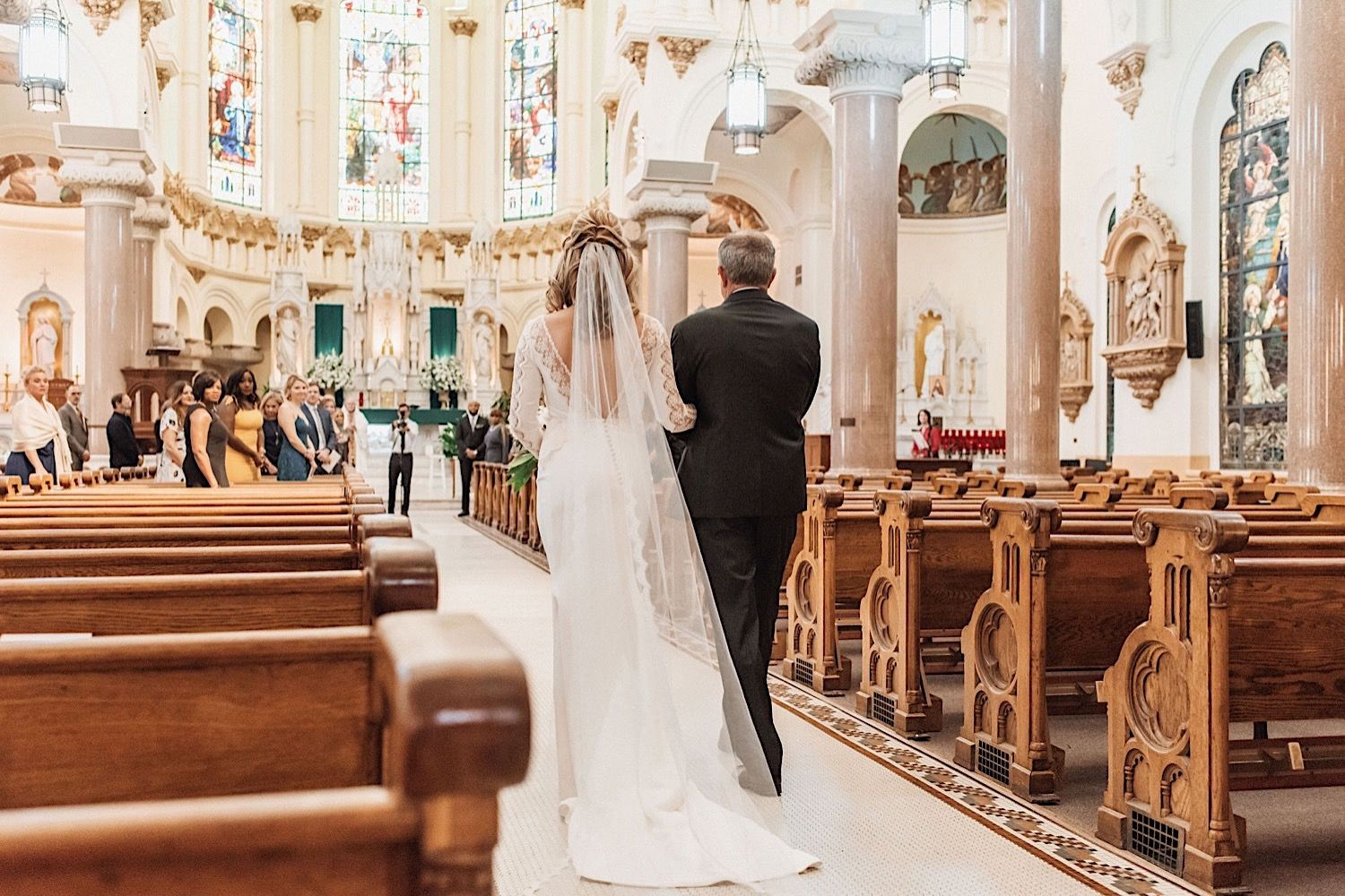 Father walking bride down the aisle at Sacred Heart Church in Tampa
