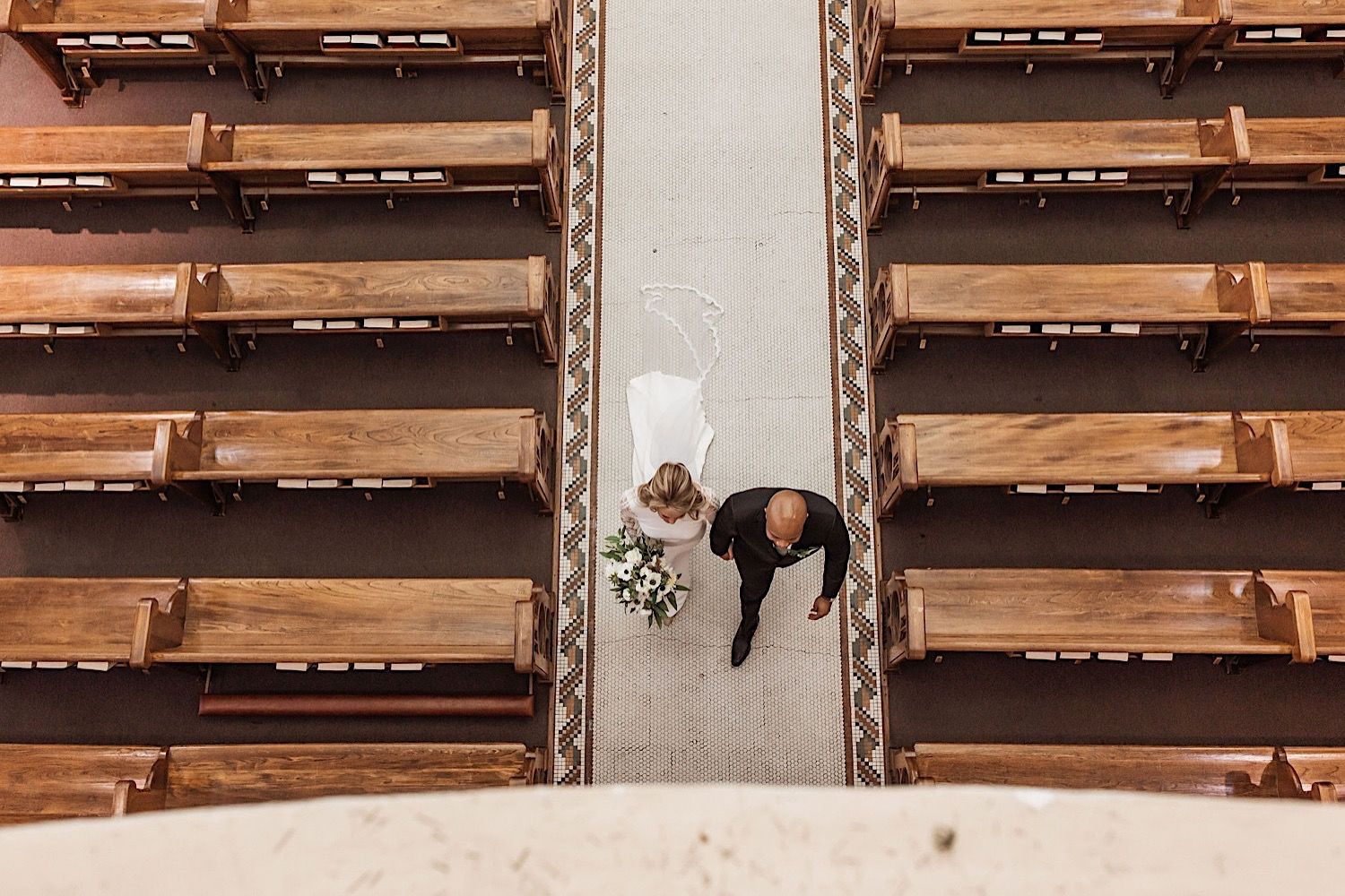 the bride and groom walking down the aisle at their wedding photographed from above