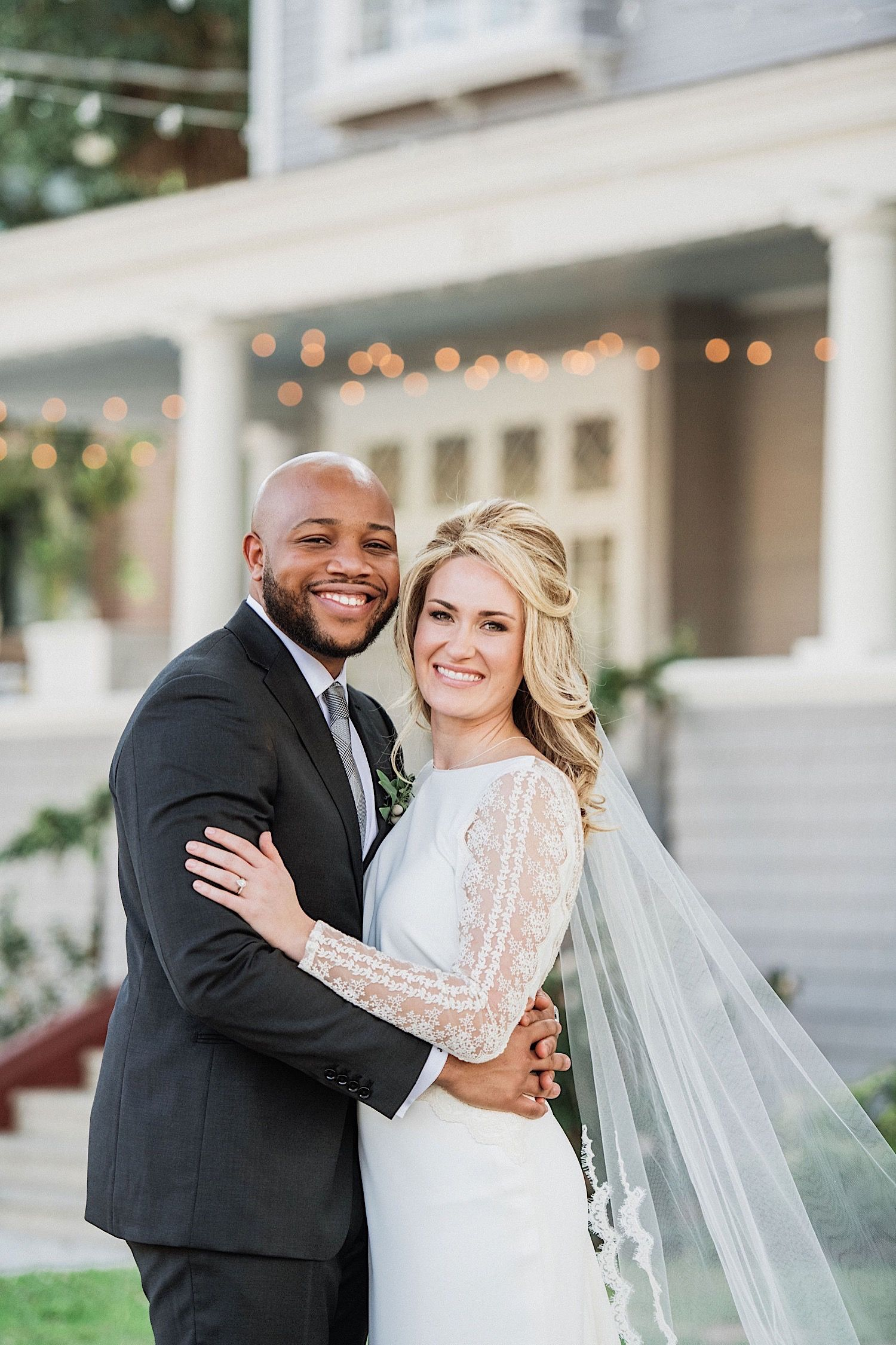 close up of bride and groom smiling in front of the Orlo in tampa