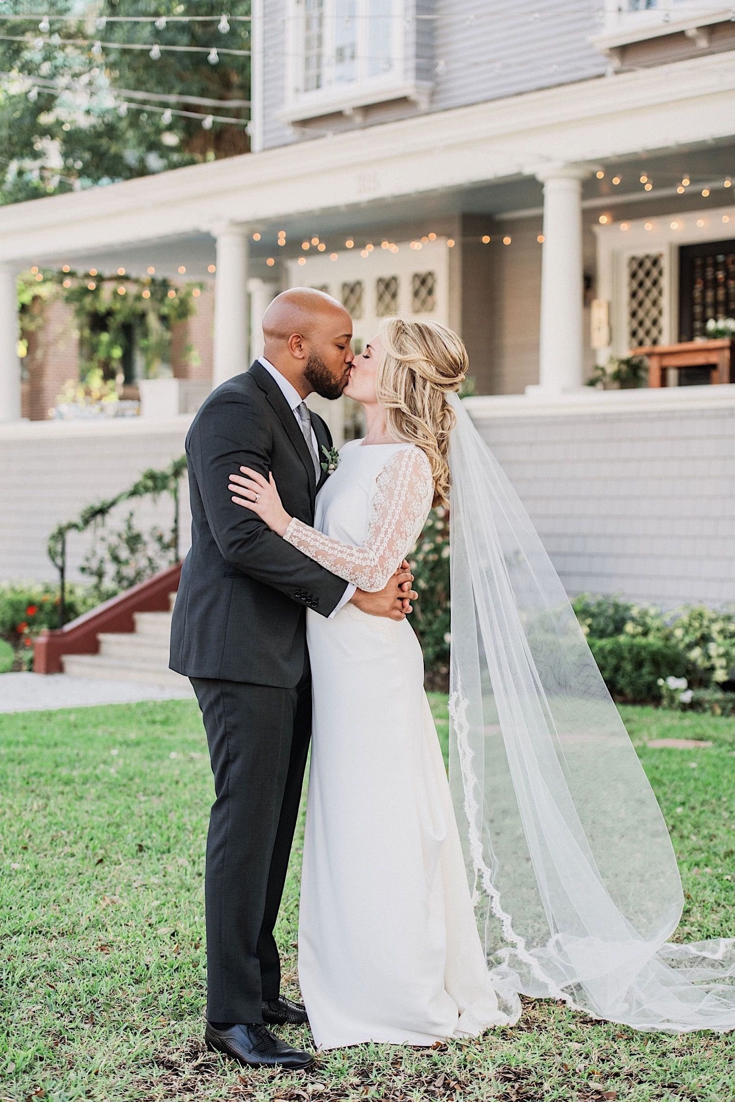 brise and groom kissing in front of the Orlo at their wedding