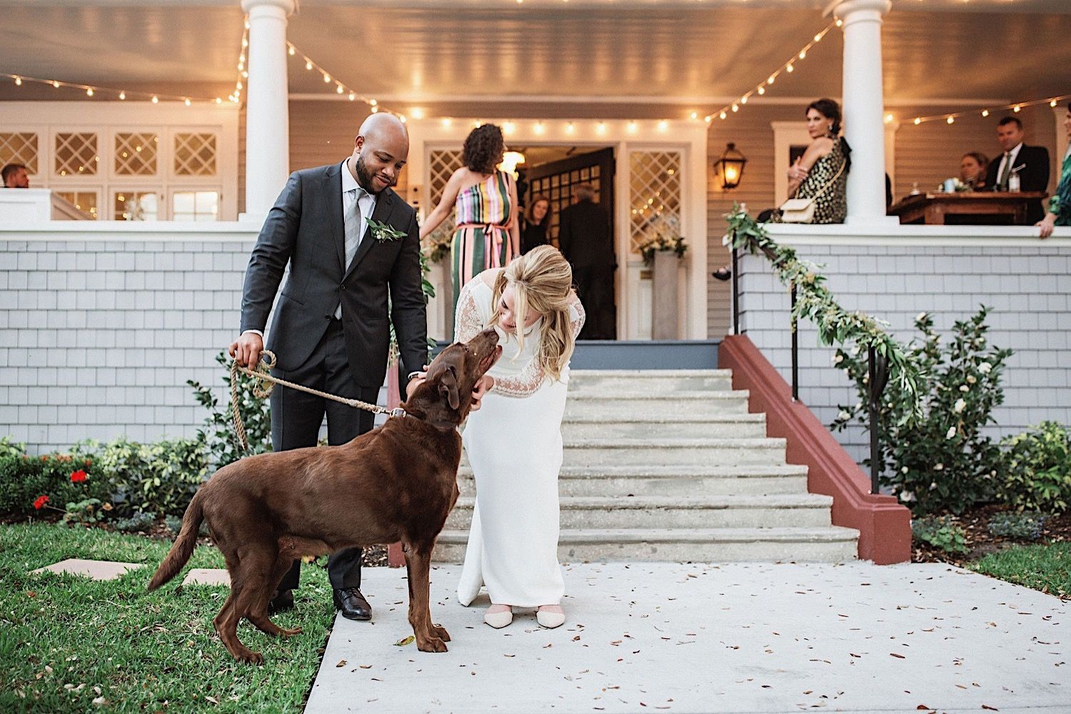 bride greeting her dog at her wedding