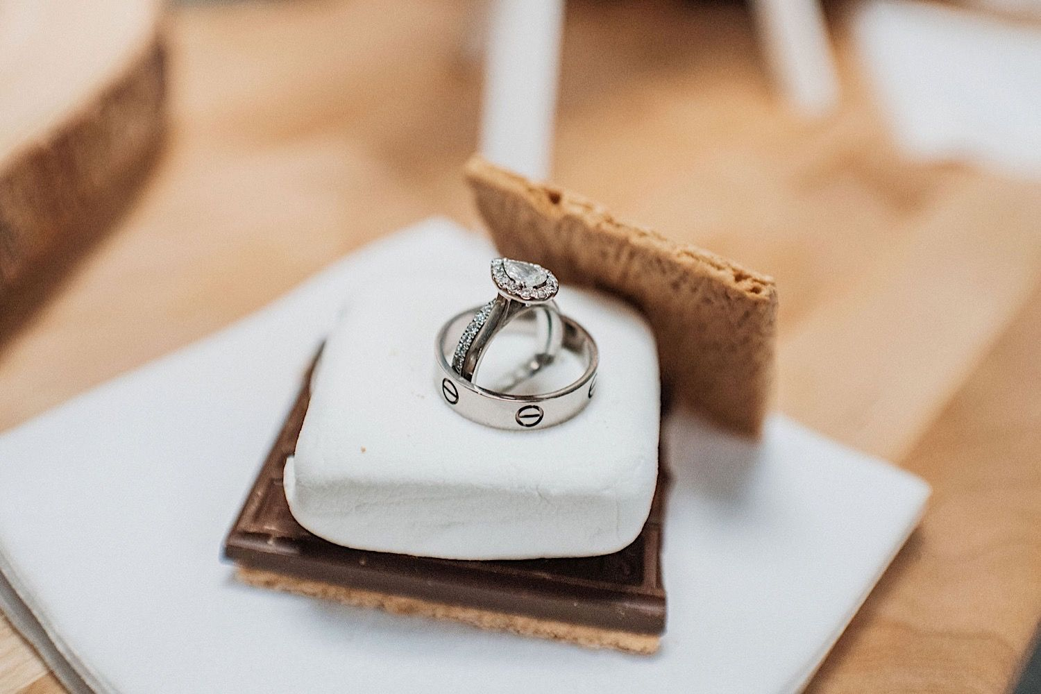 wedding and engagement rings sitting on top of a smores