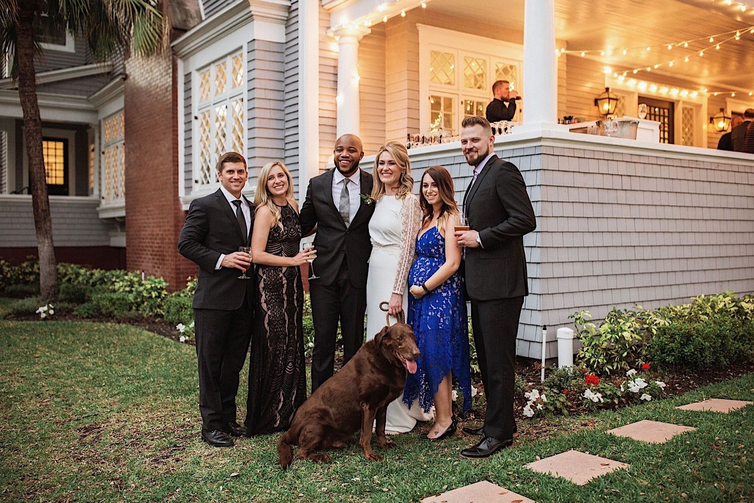 group photo with dog at a wedding at the Orlo in tampa