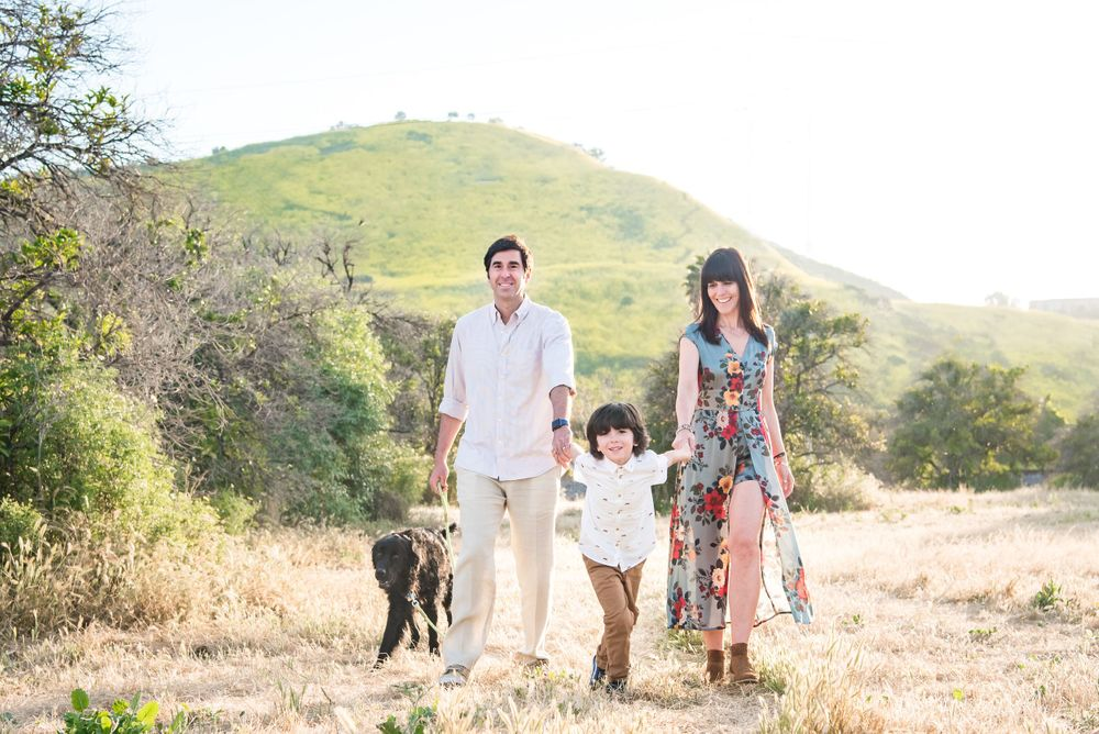 Photo of a family in a field in San Juan Capistrano, CA