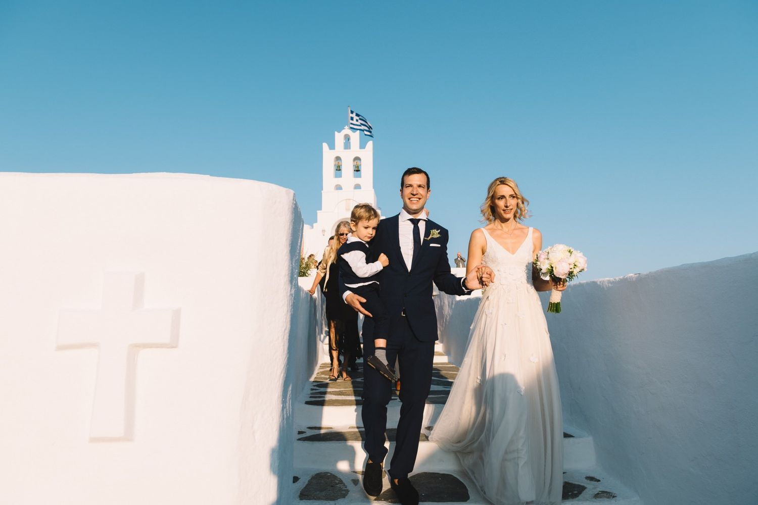 bride and groom walking after the ceremony in chrysopigi church at sifnos island