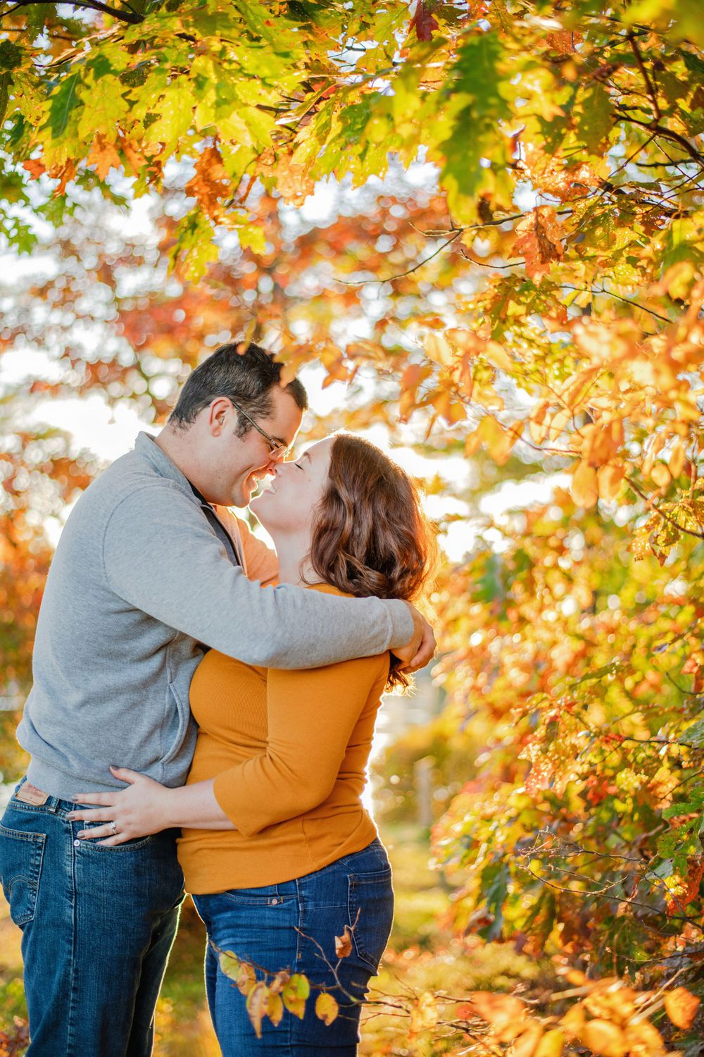 Kingston Couples Photography - Couple kissing in the fall leaves