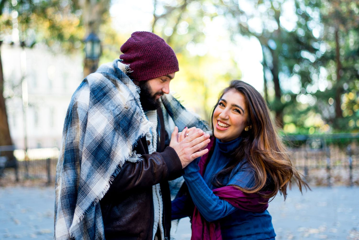 young engaged couples wrapped in a blanket in November for Manhattan Engagement Pictures