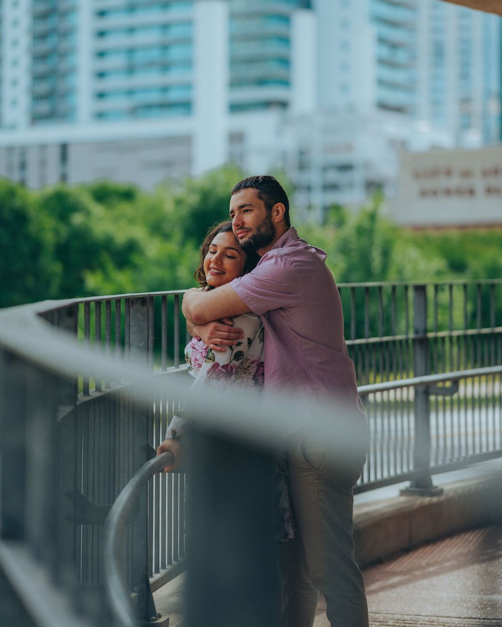 Jessica & Aldo Austin Engagement at Pfluger Pedestrian Bridge watching traffic off Cesar Chavez