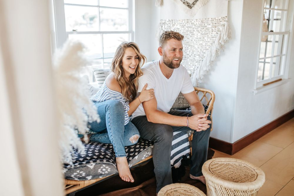 couple smiling and sitting on couch