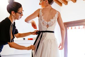photography of getting dress on for Italian wedding