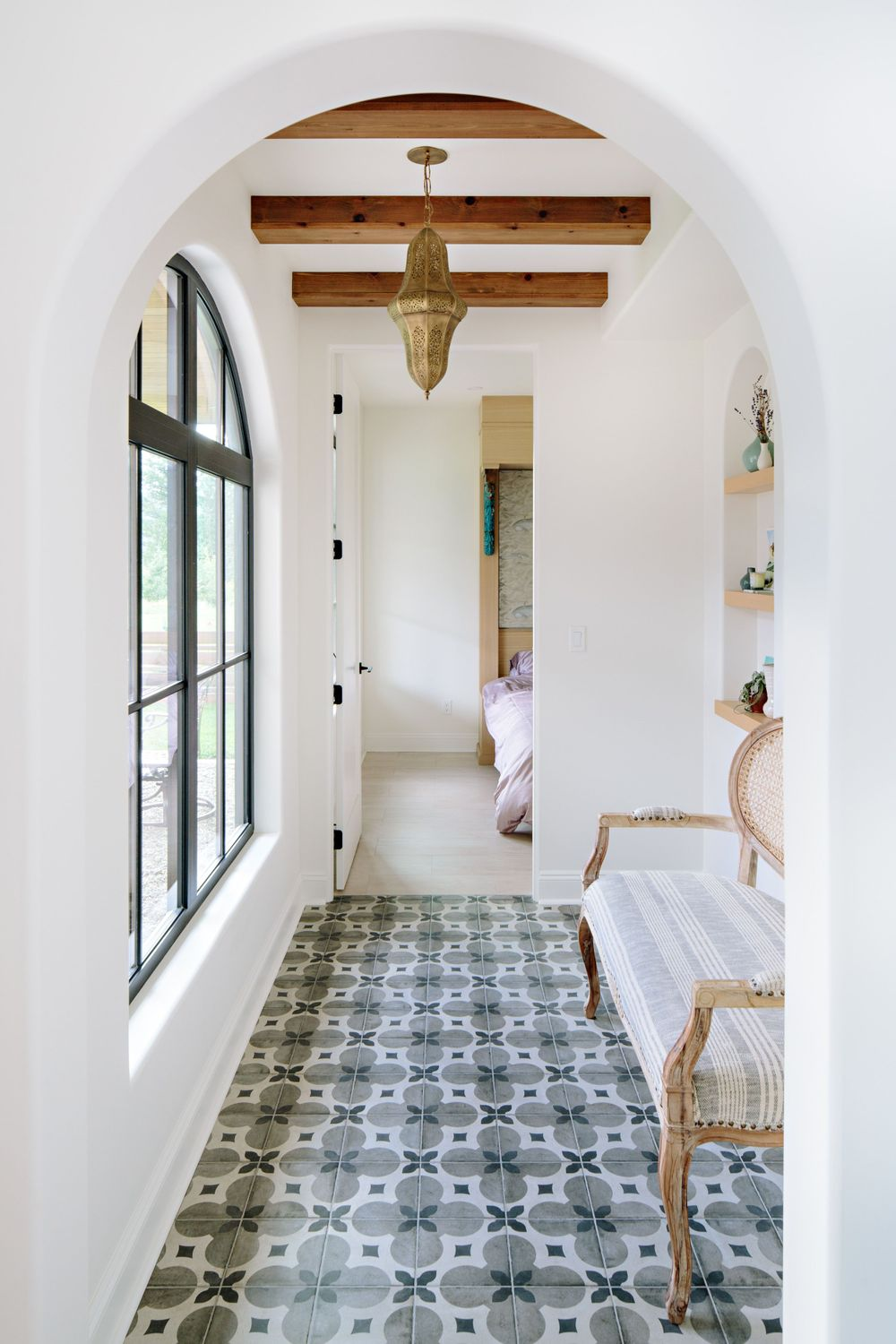 arched doorway with mosaic tile floor