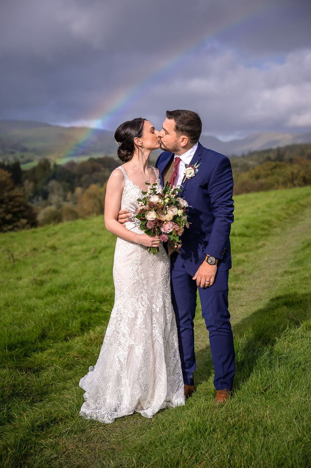 Newlyweds enjoy rainbow after Lake District wedding at Briery Wood Hotel