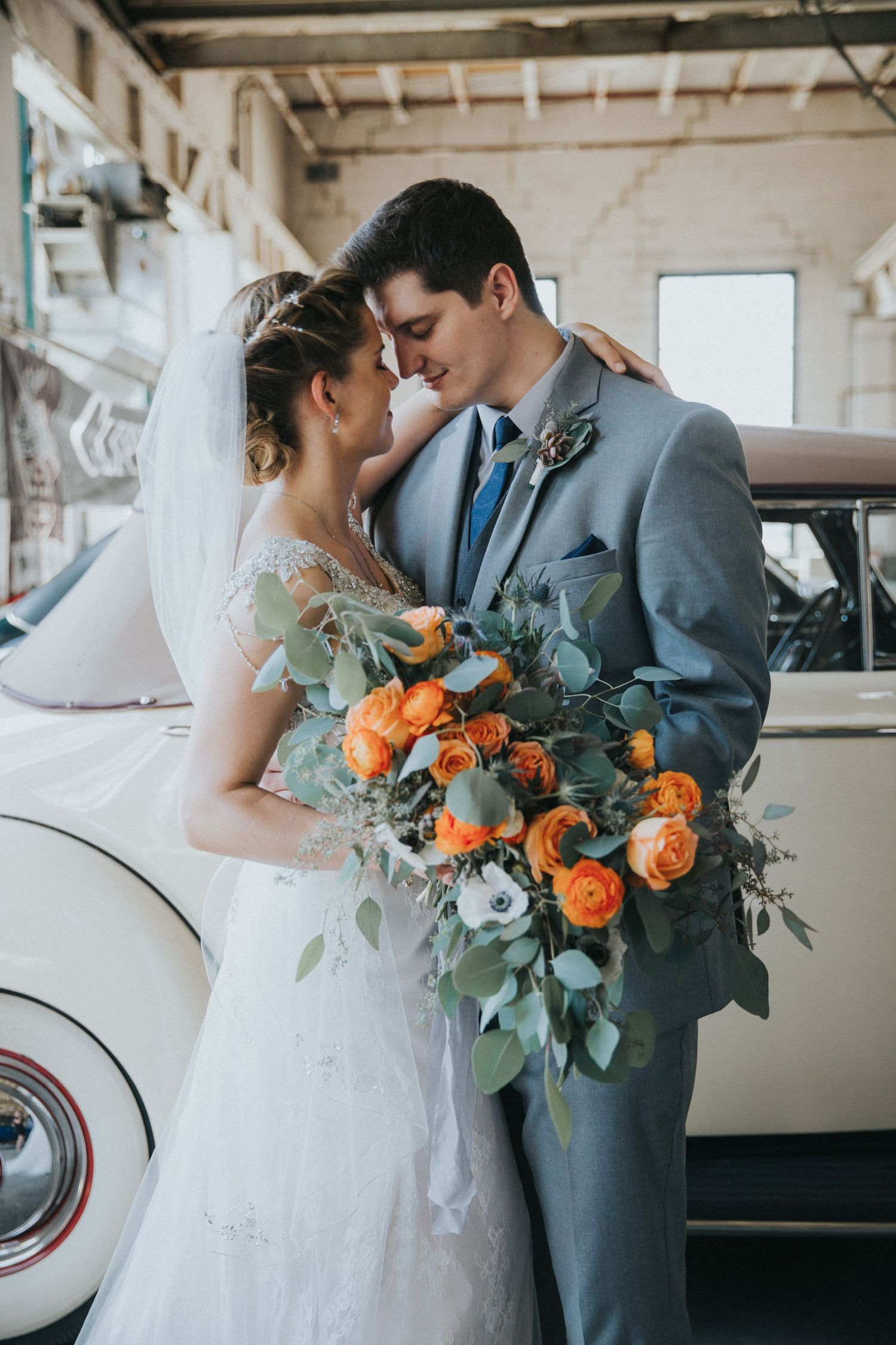 Couple ties knot at Packard Proving Grounds in Michigan. Rustic, industrial, summer wedding.