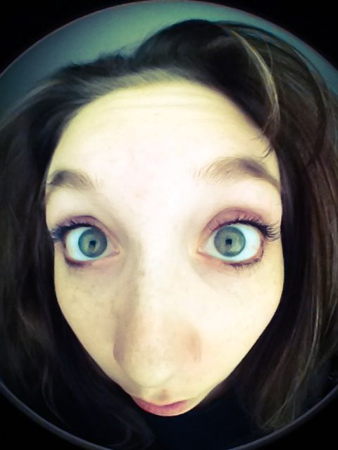 girl looking at camera with fish eye lens distortion
