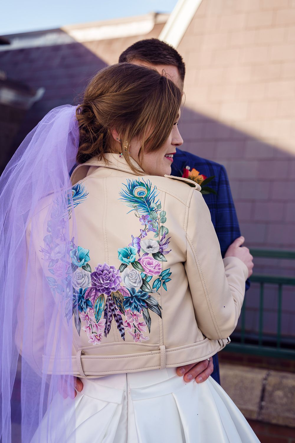 Peacock wedding theme - hand painted leather jacket with peacock feathers and purple veil.