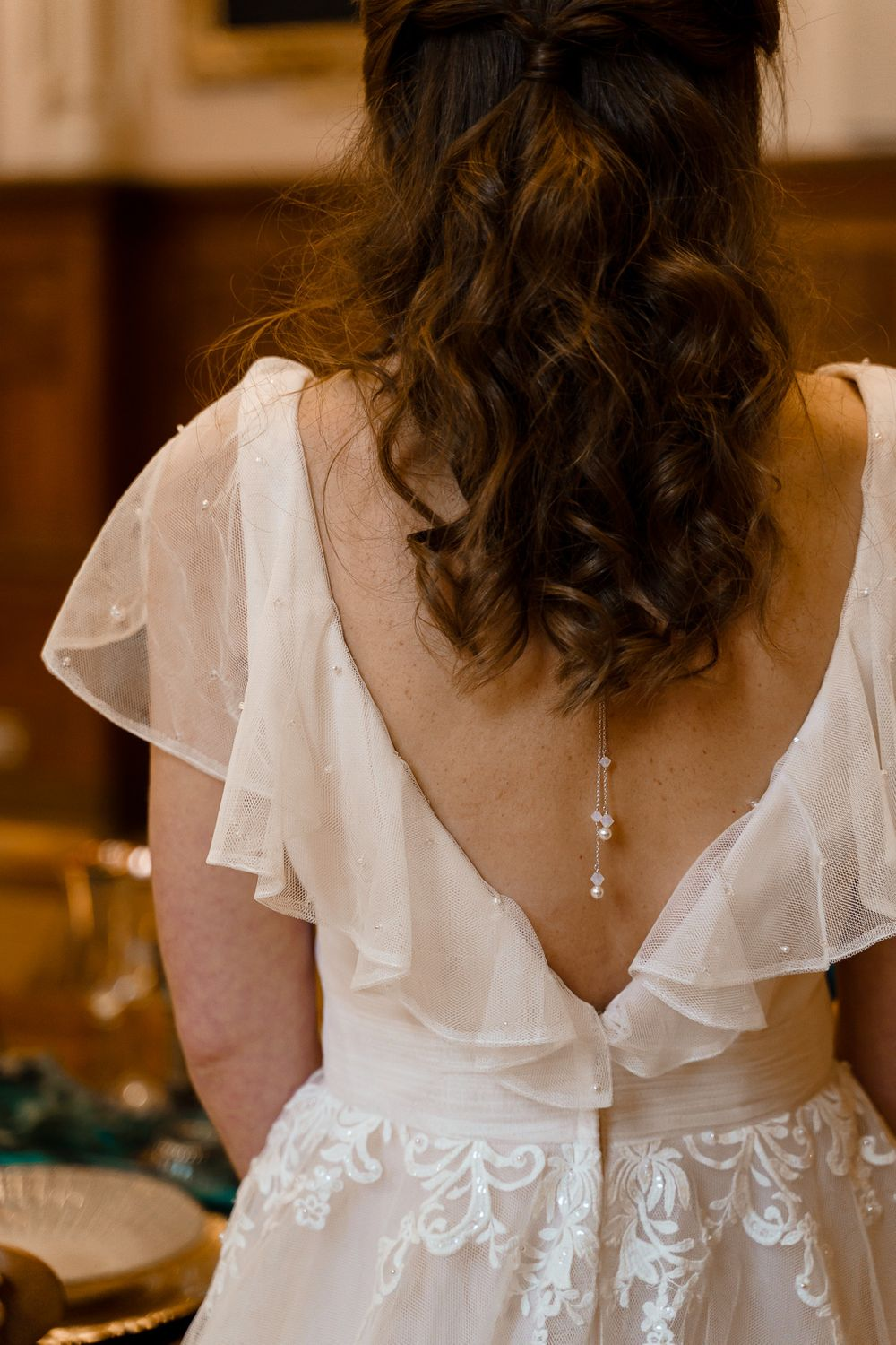 Back drop necklace on a bride in a white dress - Hampshire wedding photographer.