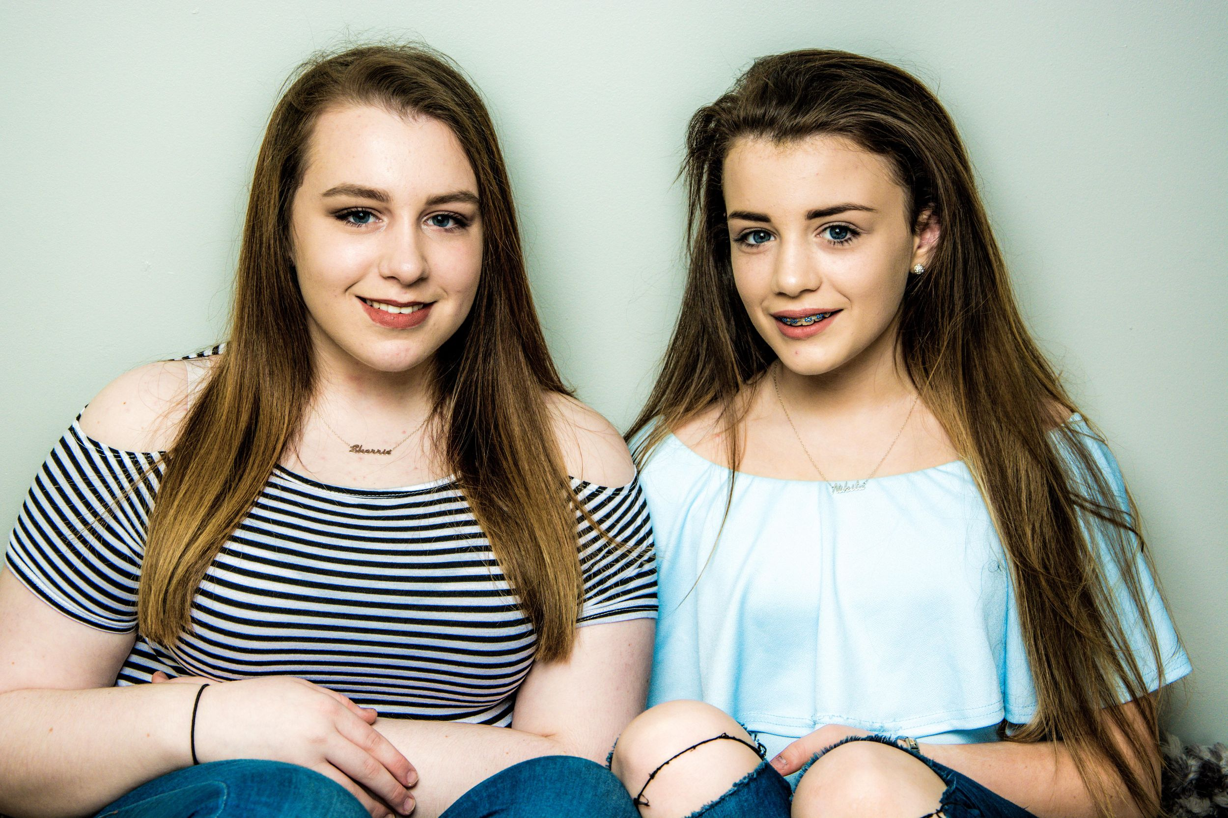 two sisters in a studio setting, ballymoney family photographer