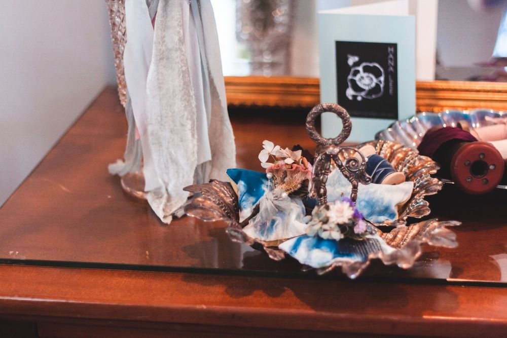 bowl of assorted jewelry on a dresser