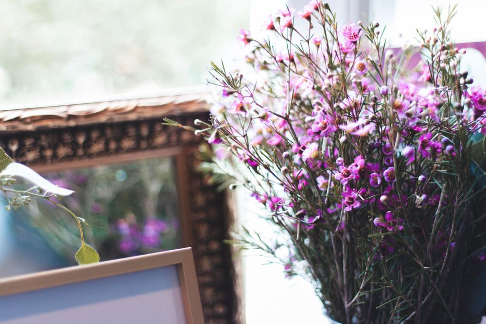 hana lee nc florals in front of picture frame