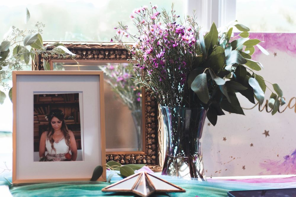 bridal picture frame with a picture of the bride inside on a dresser with flowers at a the meadows wedding venue