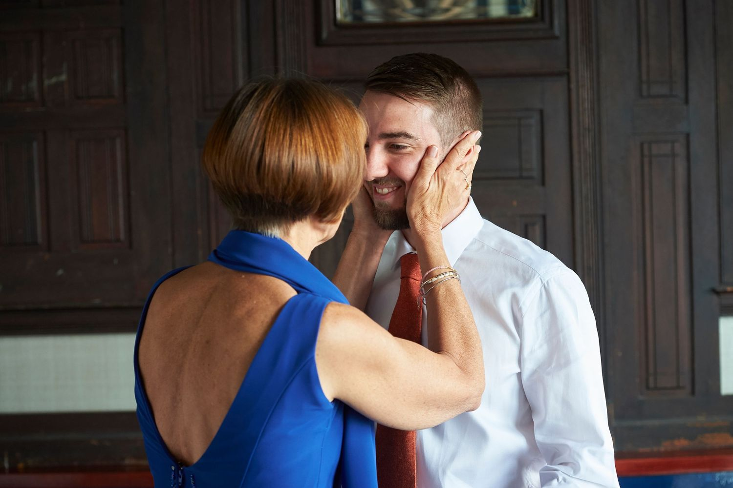 mom affectionately holds groom's face at Bonnet Island Estate