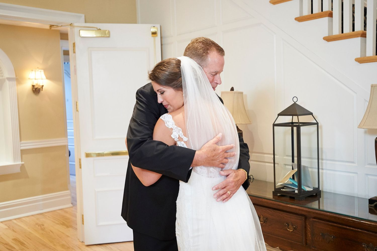 father of bride hugs daughter