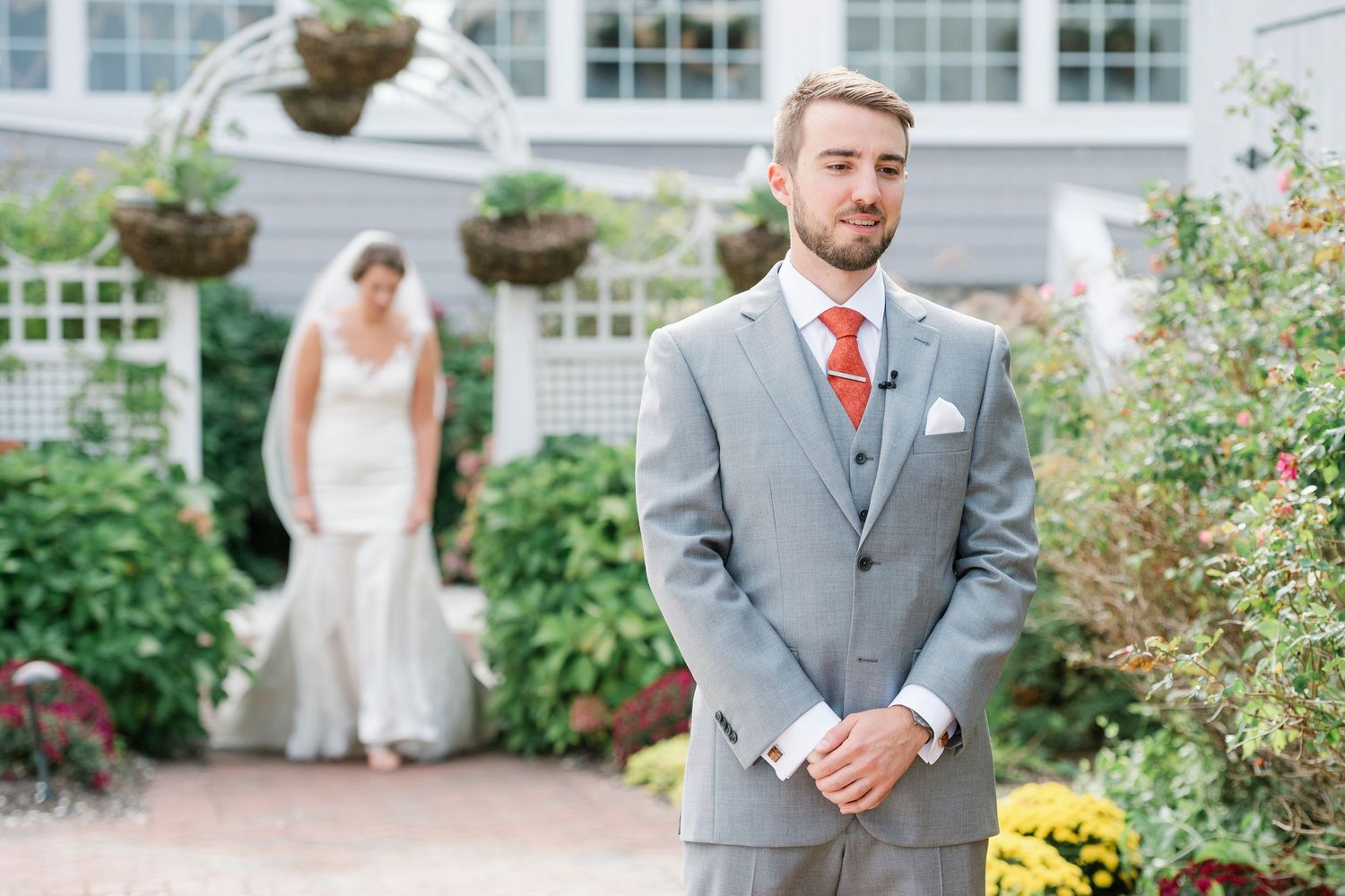 groom waits for bride during the first look at Bonnet Island Estate