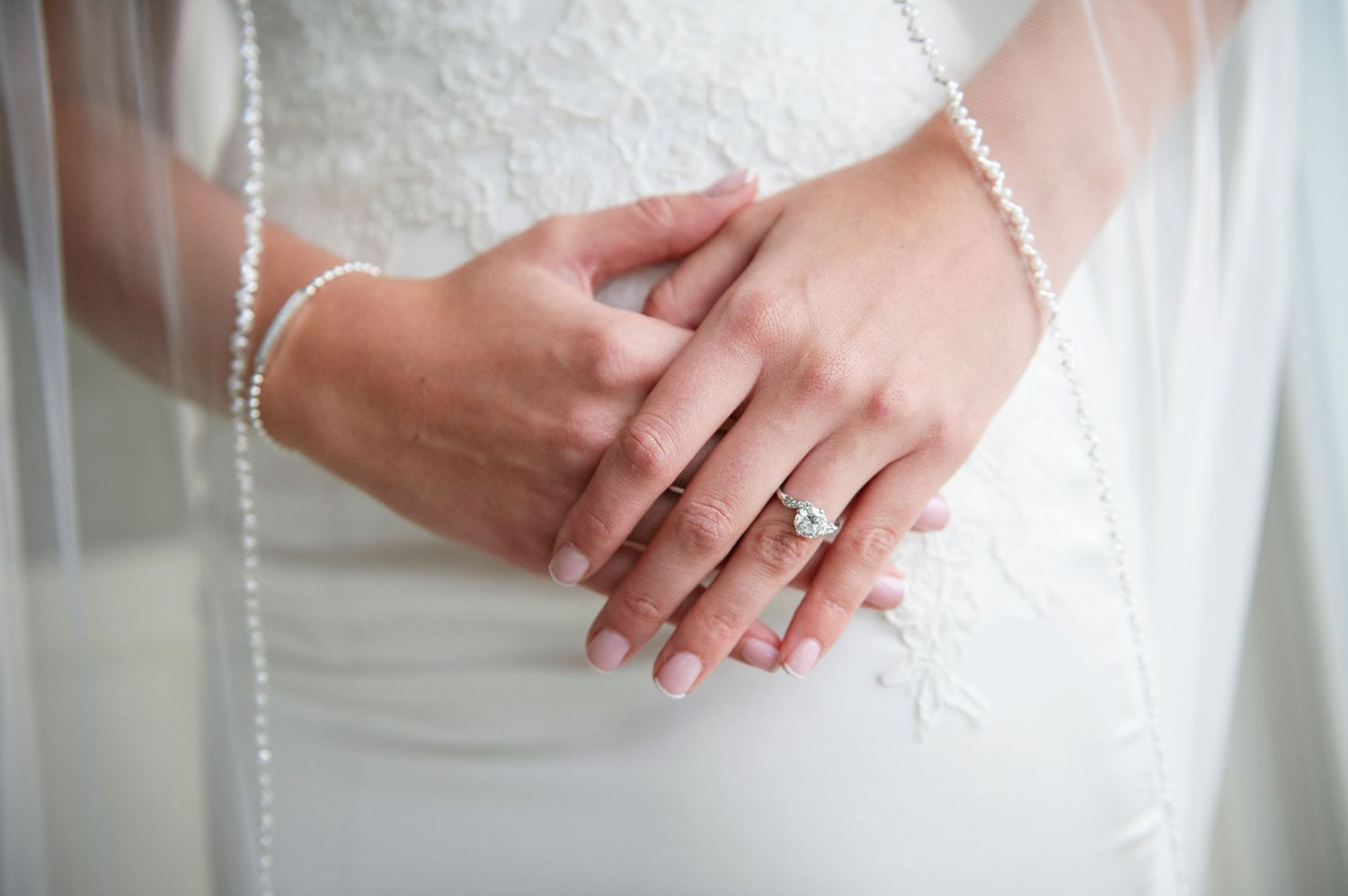bride's hands and engagement ring