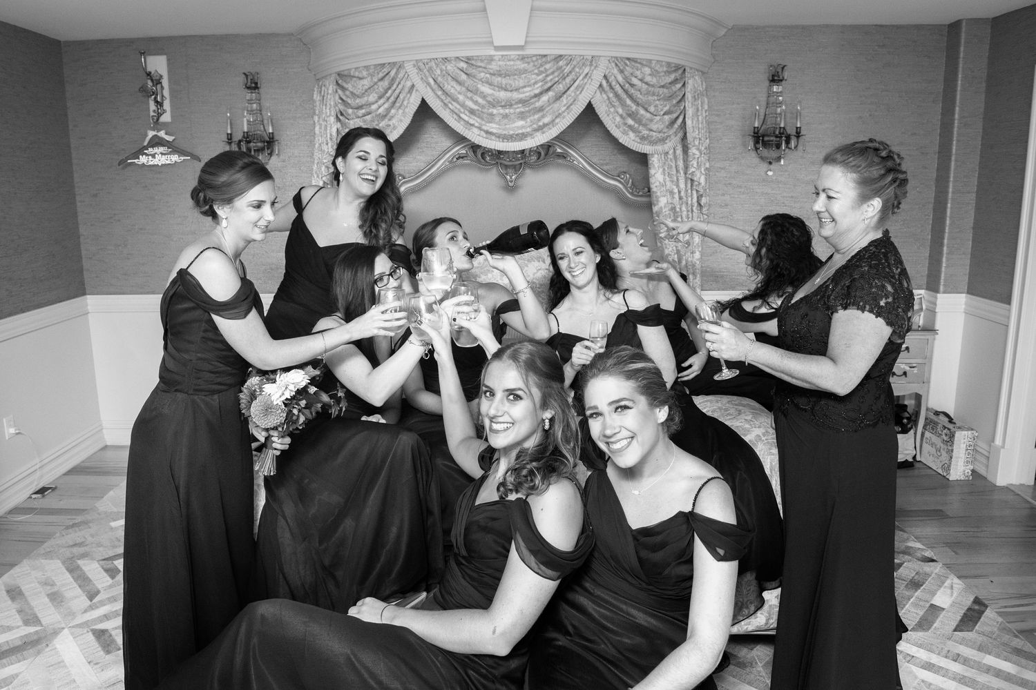 bridesmaids cheers their drinks