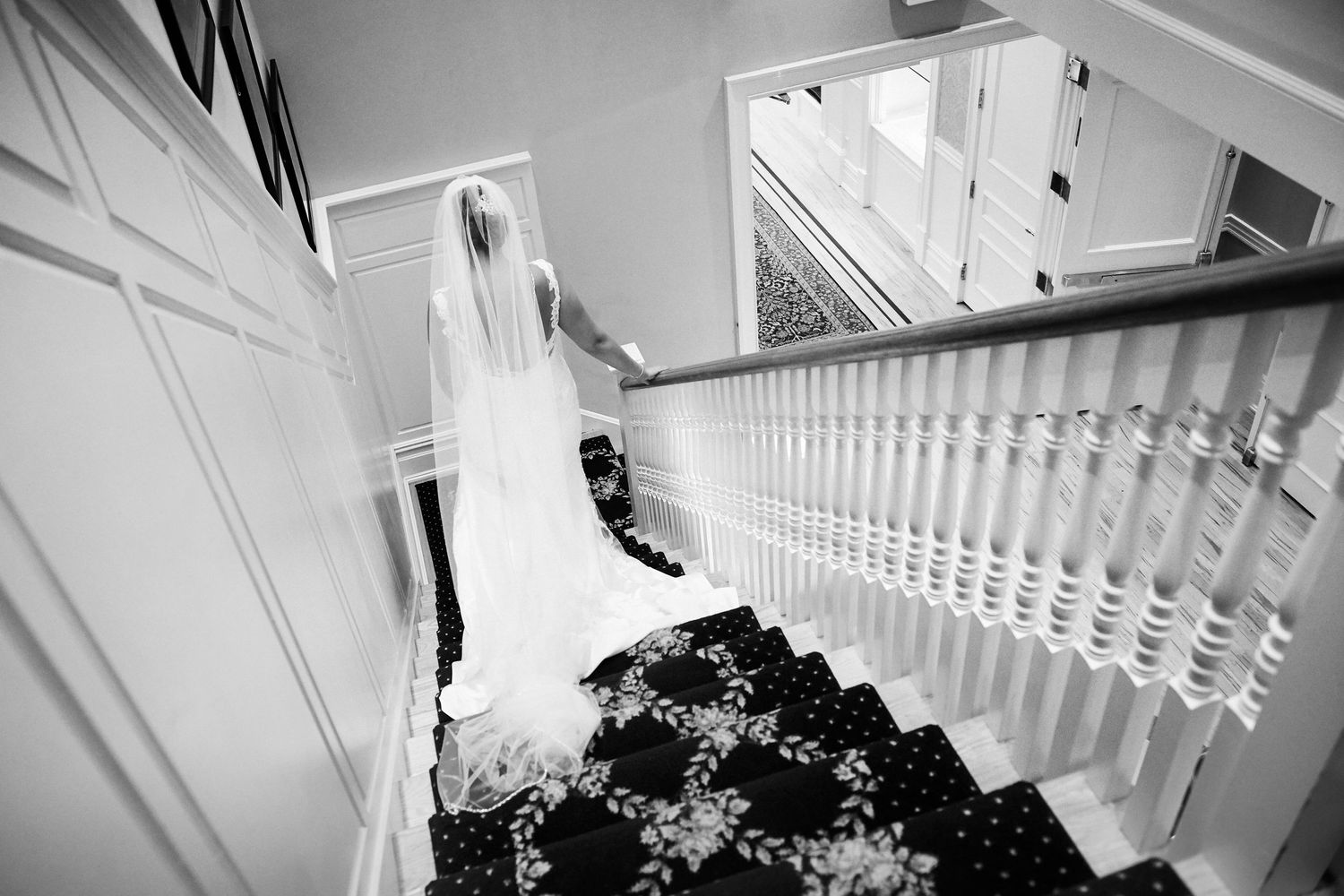 bride walking down stairs at Bonnet Island Estate