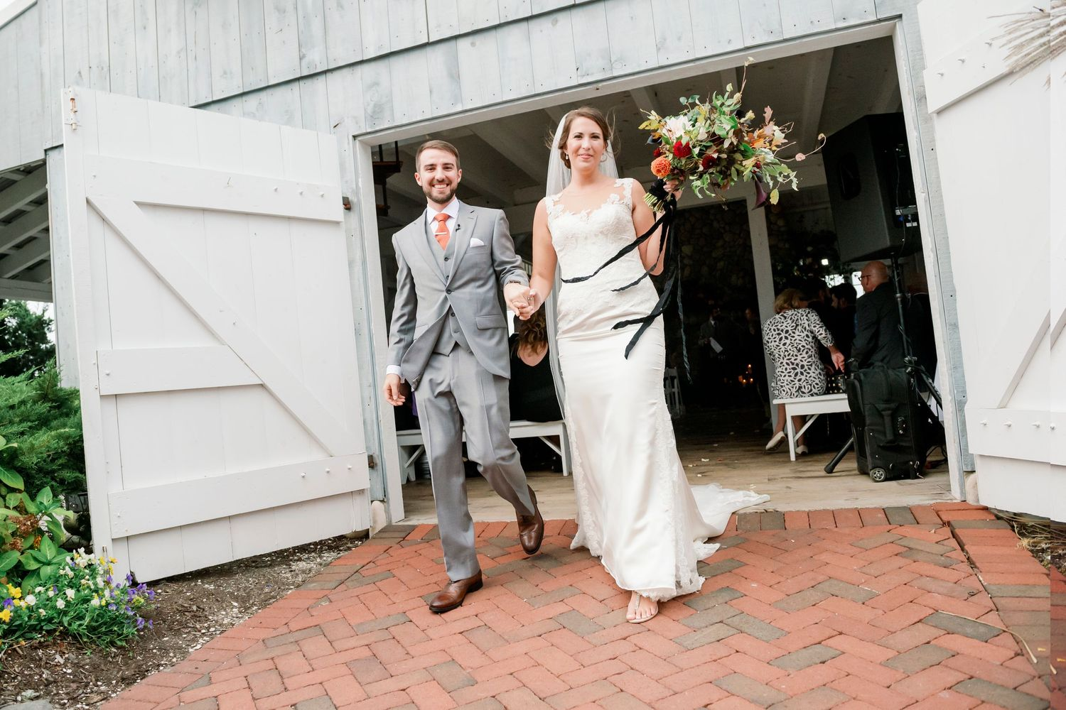 bride and groom exiting chapel at Bonnet Island Estate