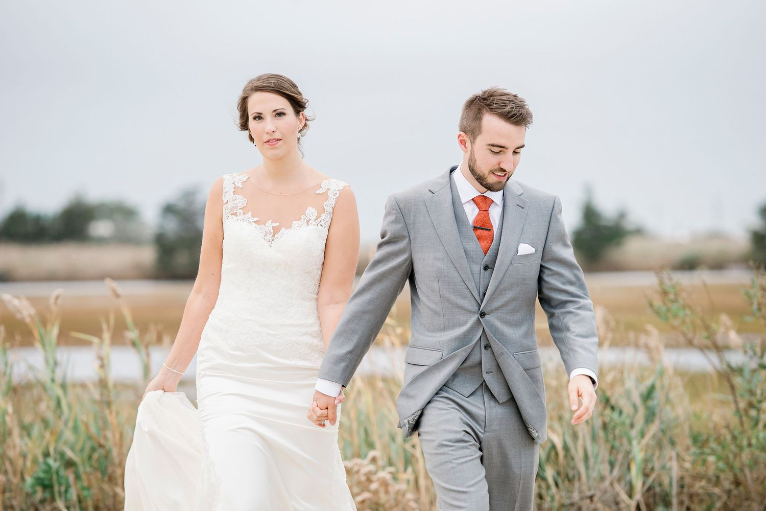 bride and groom hold hands and walk at Bonnet Island Estate