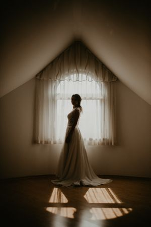Beautiful bride next to the window