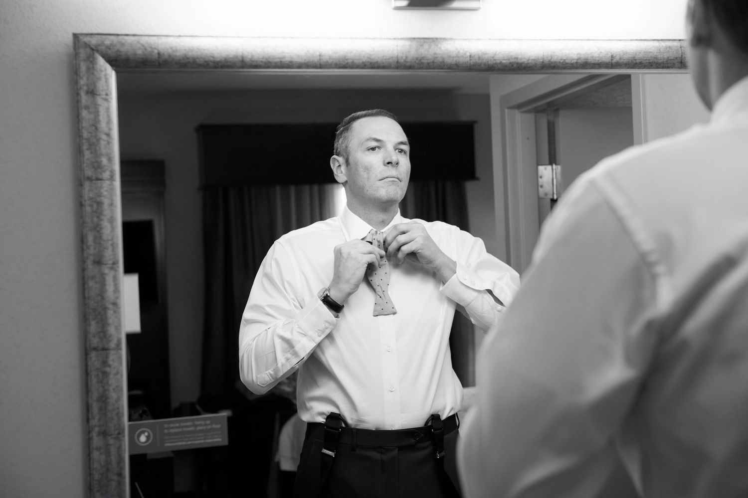 groom tying bow tie for Pen Ryn wedding