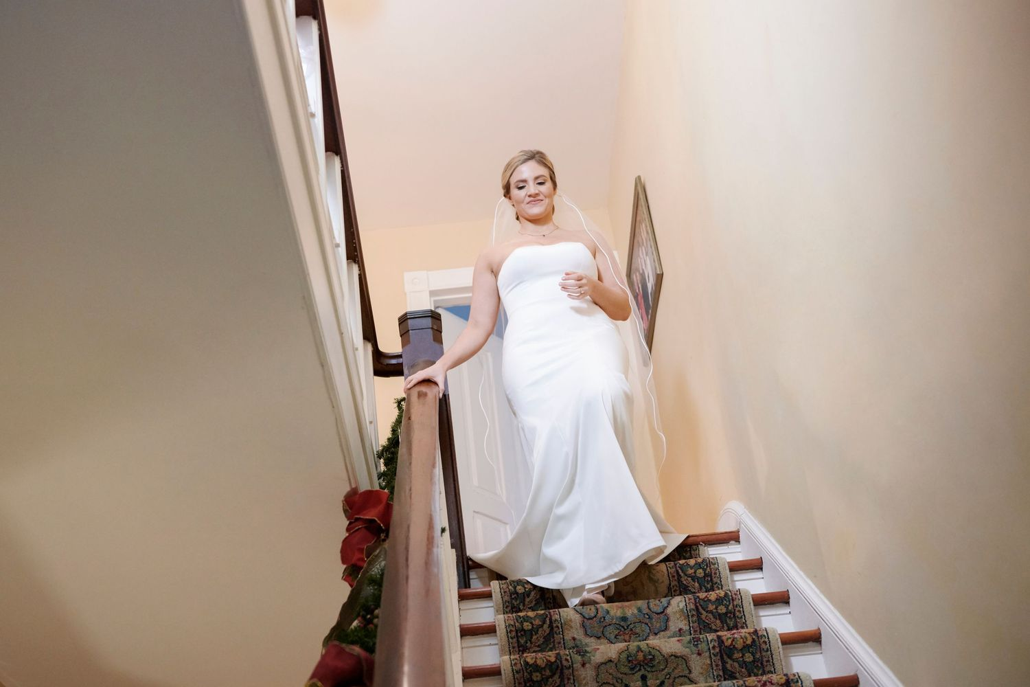 bride walking down stairs for first look with dad