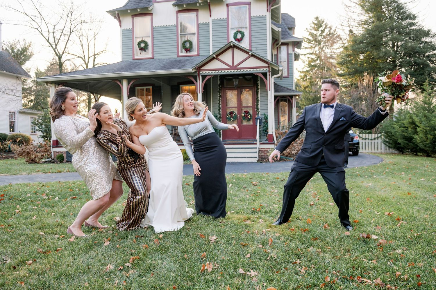 fun candid moment between bride and her siblings