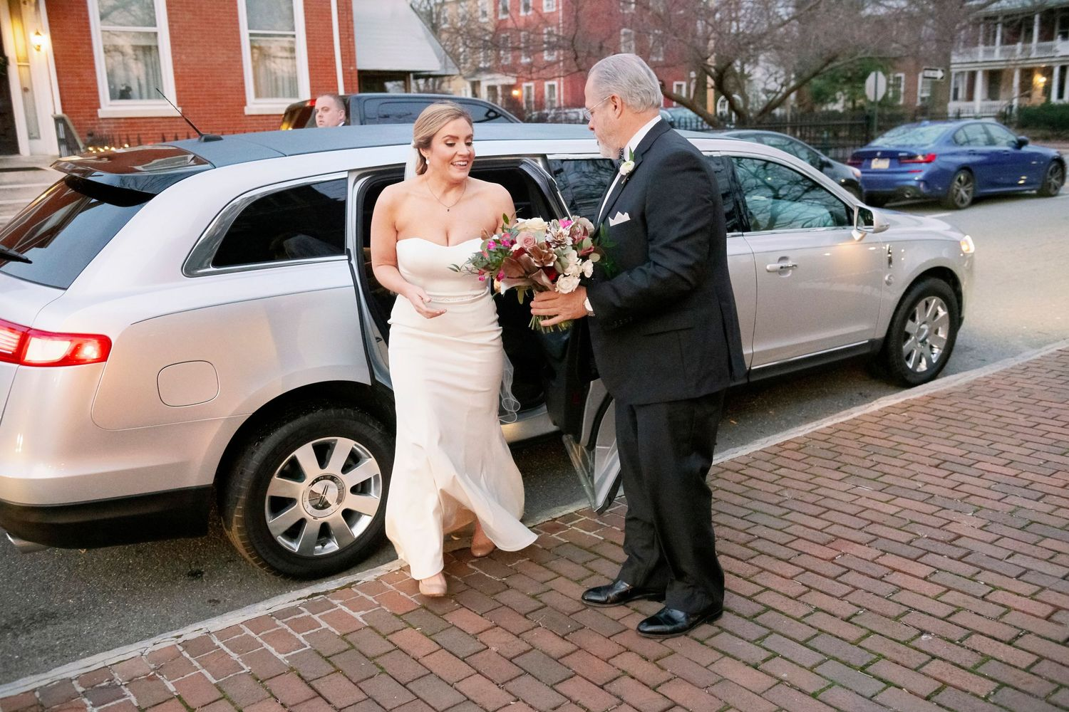Bride exiting limo with dad's help