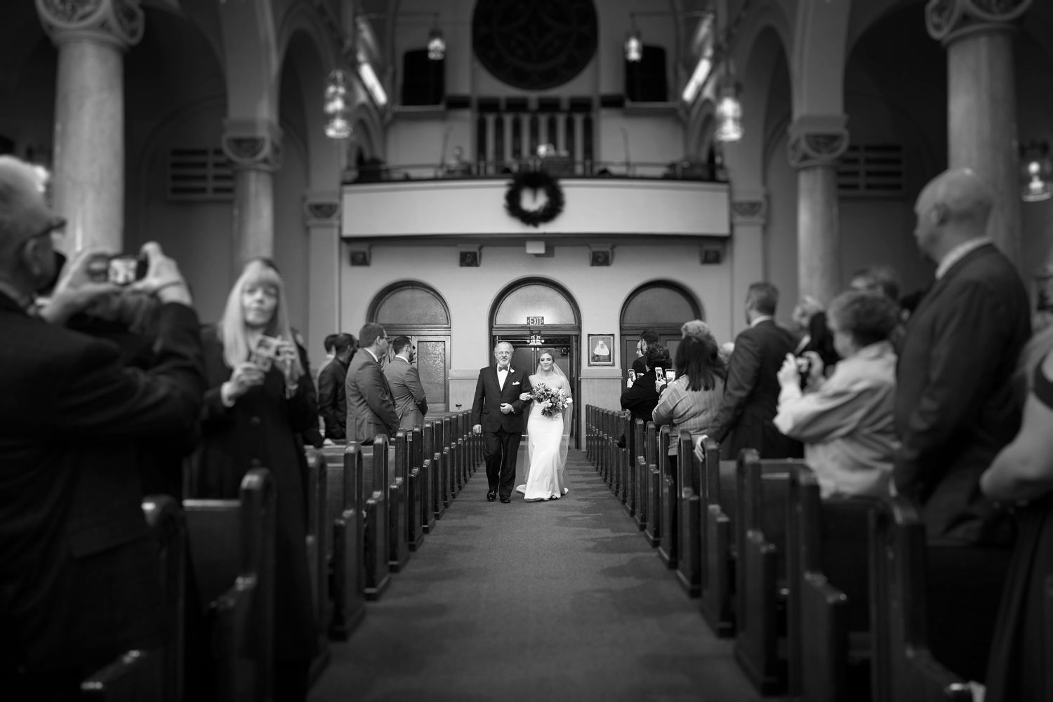 bride and father walking down isle at church