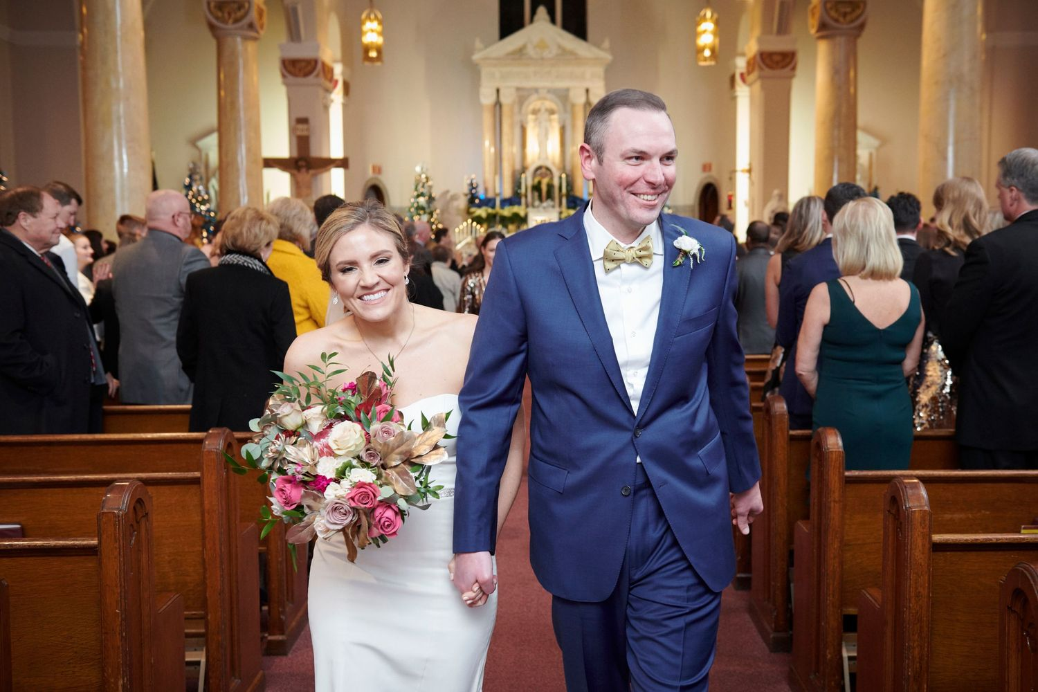 bride and groom recessional down isle at church